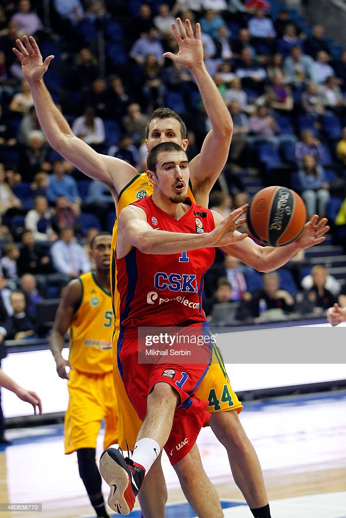 Nando De Colo #1 of CSKA Moscow competes with Trent Plaisted #44 of Limoges CSP during the 20142015 Turkish Airlines Euroleague Basketball Regular...