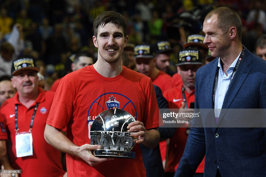 Nando De Colo #1 of CSKA Moscow receives from Ramunas Siskaukas former Basketball player the MVP Trophy at the end of the Turkish Airlines Euroleague...