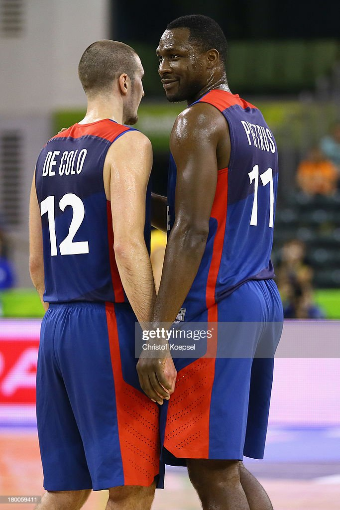 <a gi-track='captionPersonalityLinkClicked' href=/galleries/search?phrase=Nando+De+Colo&family=editorial&specificpeople=4689603 ng-click='$event.stopPropagation()'>Nando De Colo</a> and <a gi-track='captionPersonalityLinkClicked' href=/galleries/search?phrase=Florent+Pietrus&family=editorial&specificpeople=713034 ng-click='$event.stopPropagation()'>Florent Pietrus</a> of France smile during the FIBA European Championships 2013 first round group A match between Ukraine and France at Tivoli Arena on September 8, 2013 in Ljubljana, Slovenia.