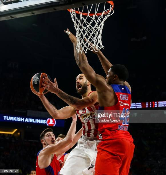 Nando De Colo and Kyle Hines of CSKA Moscow in action against Vassilis Spanoulis of Olympiacos during the Turkish Airlines Euroleague Final Four...