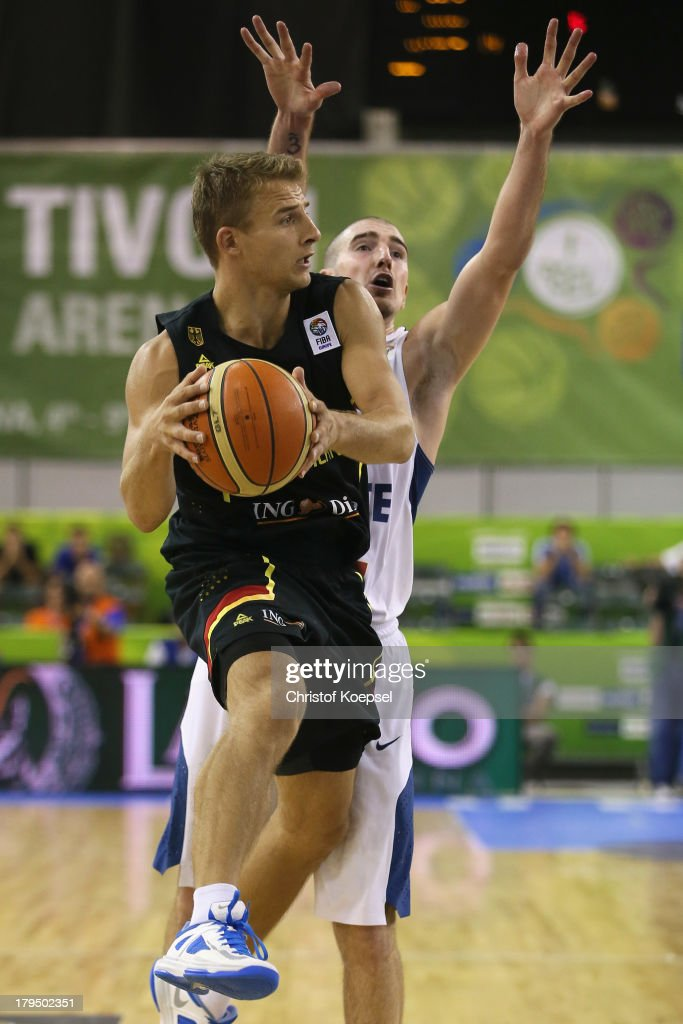 Nando De Colo of France (R) defends against Heiko Schaffartzik of Gemany during the FIBA European Championships 2013 first round group A match between France and Germany at Tivoli Arena on September 4, 2013 in Ljubljana, Slovenia.