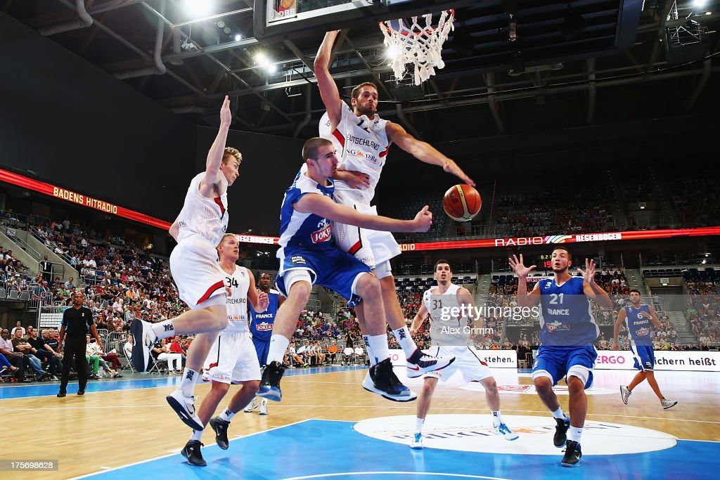Nando de Colo of France passes the ball against Jonas WohlfahrtBottermann of Germany during the international friendly match between Germany and...
