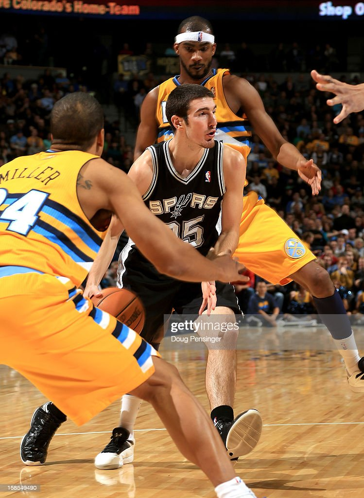 Nando de Colo #25 of the San Antonio Spurs controls the ball against <a gi-track='captionPersonalityLinkClicked' href=/galleries/search?phrase=Andre+Miller&family=editorial&specificpeople=201678 ng-click='$event.stopPropagation()'>Andre Miller</a> #24 of the Denver Nuggets and <a gi-track='captionPersonalityLinkClicked' href=/galleries/search?phrase=Corey+Brewer&family=editorial&specificpeople=234749 ng-click='$event.stopPropagation()'>Corey Brewer</a> #13 of the Denver Nuggets at the Pepsi Center on December 18, 2012 in Denver, Colorado. The Nuggets defeated the Spurs 112-106.
