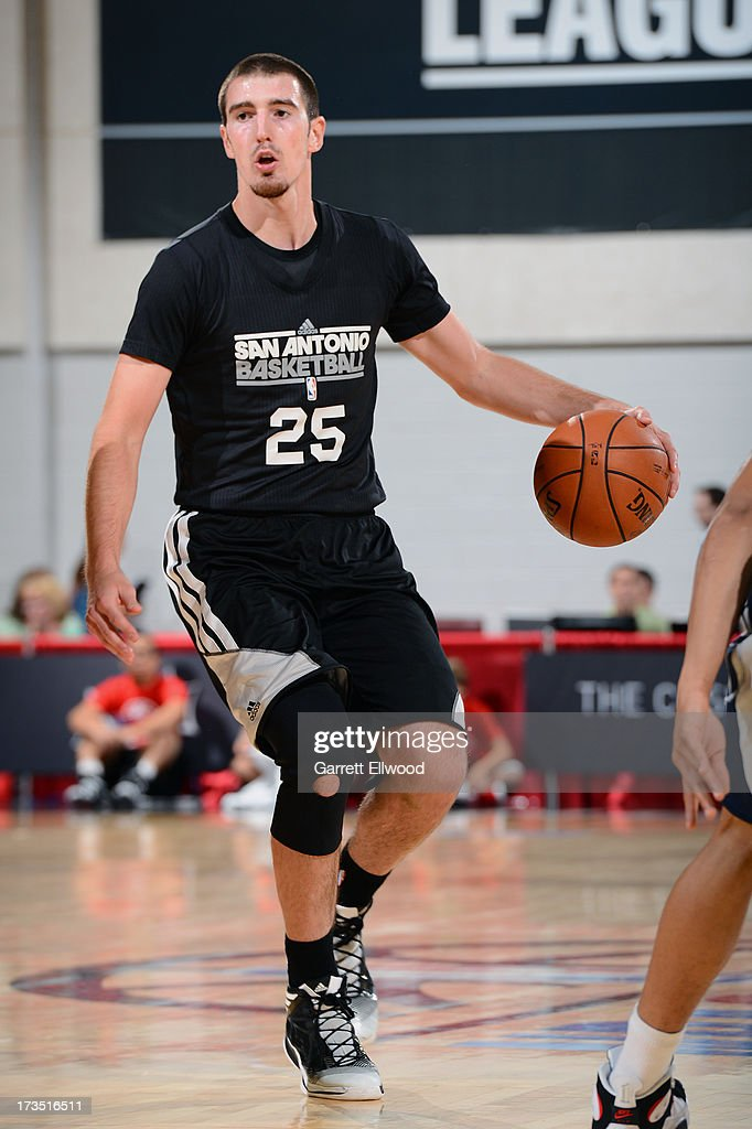 Nando De Colo #25 of the San Antonio Spurs dribbles the ball against the Atlanta Hawks during NBA Summer League on July 15, 2013 at the Cox Pavilion in Las Vegas, Nevada.