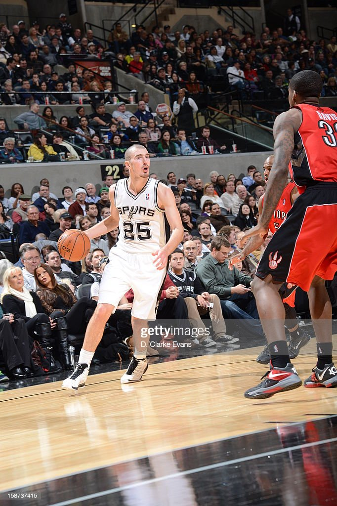 Nando de Colo #25 of the San Antonio Spurs drives during the game between the Toronto Raptors and the San Antonio Spurs on December 26, 2012 at the AT&T Center in San Antonio, Texas.