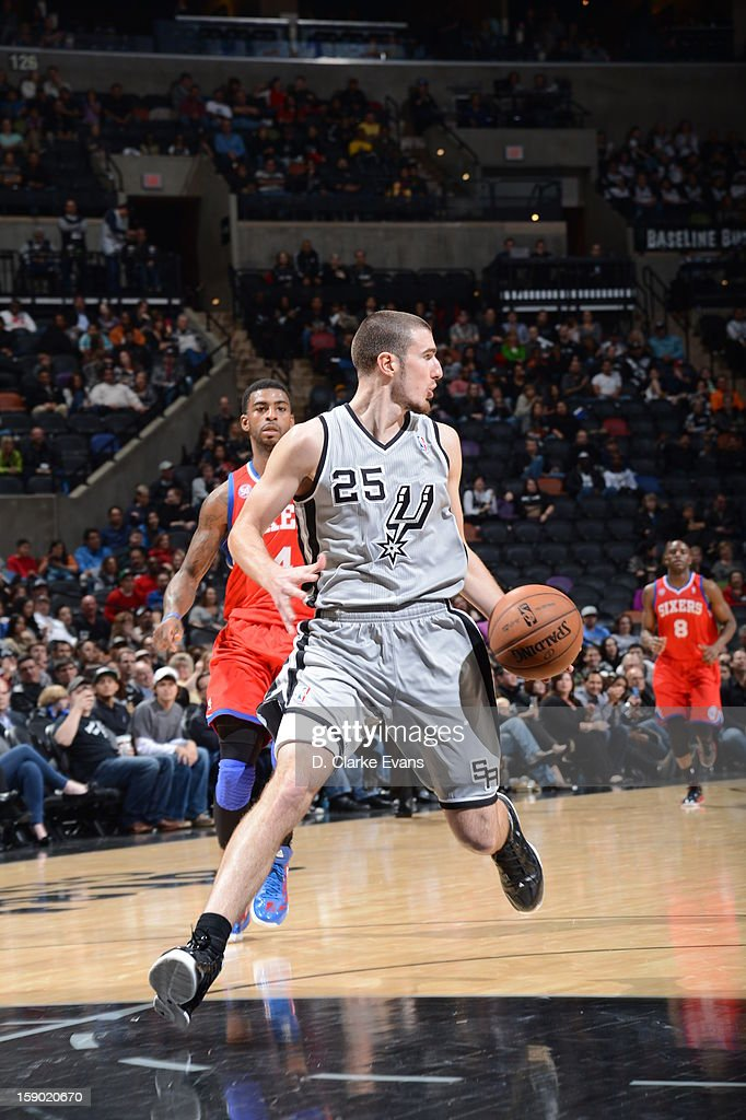 Nando de Colo #25 of the San Antonio Spurs drives during the game between the Philadelphia 76ers and the San Antonio Spurs on January 5, 2013 at the AT&T Center in San Antonio, Texas.