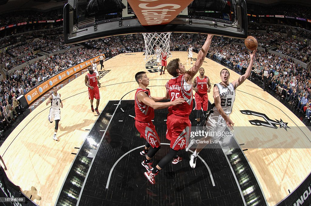 Nando de Colo #25 of the San Antonio Spurs drives to the basket against <a gi-track='captionPersonalityLinkClicked' href=/galleries/search?phrase=Chandler+Parsons&family=editorial&specificpeople=4249869 ng-click='$event.stopPropagation()'>Chandler Parsons</a> #25 of the Houston Rockets on December 7, 2012 at the AT&T Center in San Antonio, Texas.