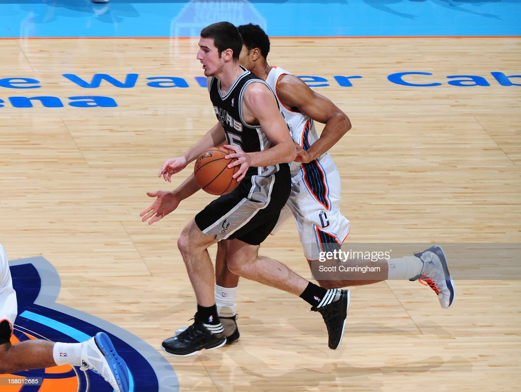 Nando de Colo #25 of the San Antonio Spurs drives to the basket against of the Charlotte Bobcats at Time Warner Cable Arena on December 8, 2012 in Charlotte, North Carolina.