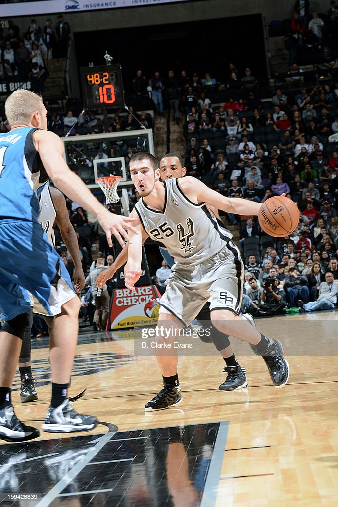 Nando de Colo #25 of the San Antonio Spurs drives to the basket against the Minnesota Timberwolves on January 13, 2013 at the AT&T Center in San Antonio, Texas.