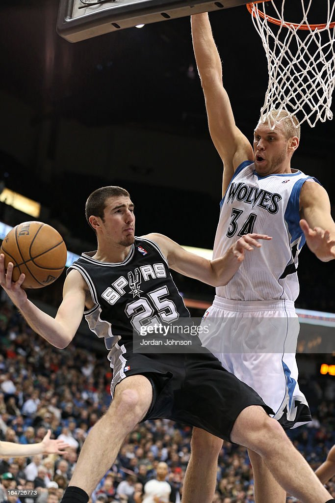 Nando de Colo #25 of the San Antonio Spurs drives to the basket against the Minnesota Timberwolves on March 12, 2013 at Target Center in Minneapolis, Minnesota.