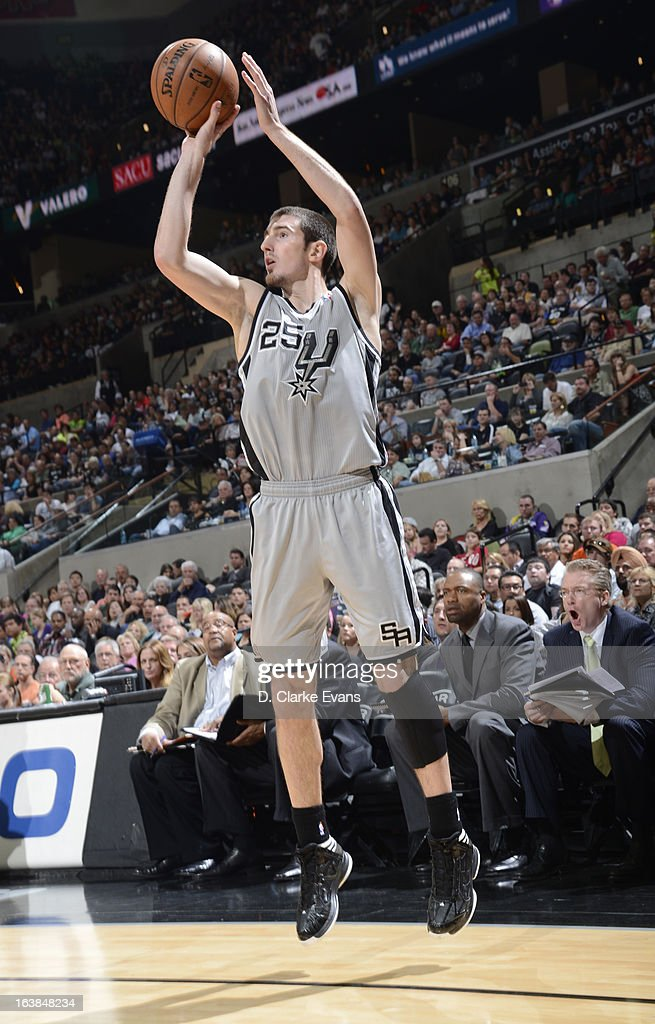 Nando de Colo #25 of the San Antonio Spurs goes for a jump shot during the game between the Cleveland Cavaliers and the San Antonio Spurs on March 16, 2013 at the AT&T Center in San Antonio, Texas.