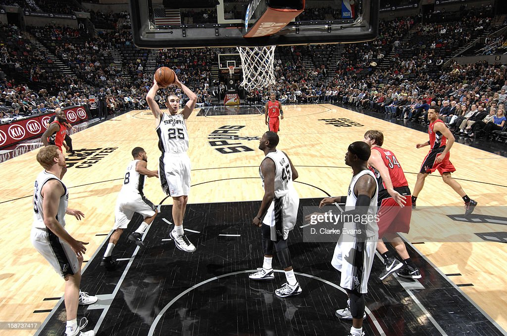Nando de Colo #25 of the San Antonio Spurs goes to the basket during the game between the Toronto Raptors and the San Antonio Spurs on December 26, 2012 at the AT&T Center in San Antonio, Texas.