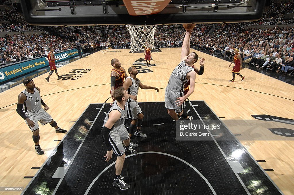 Nando de Colo #25 of the San Antonio Spurs goes to the basket during the game between the Cleveland Cavaliers and the San Antonio Spurs on March 16, 2013 at the AT&T Center in San Antonio, Texas.