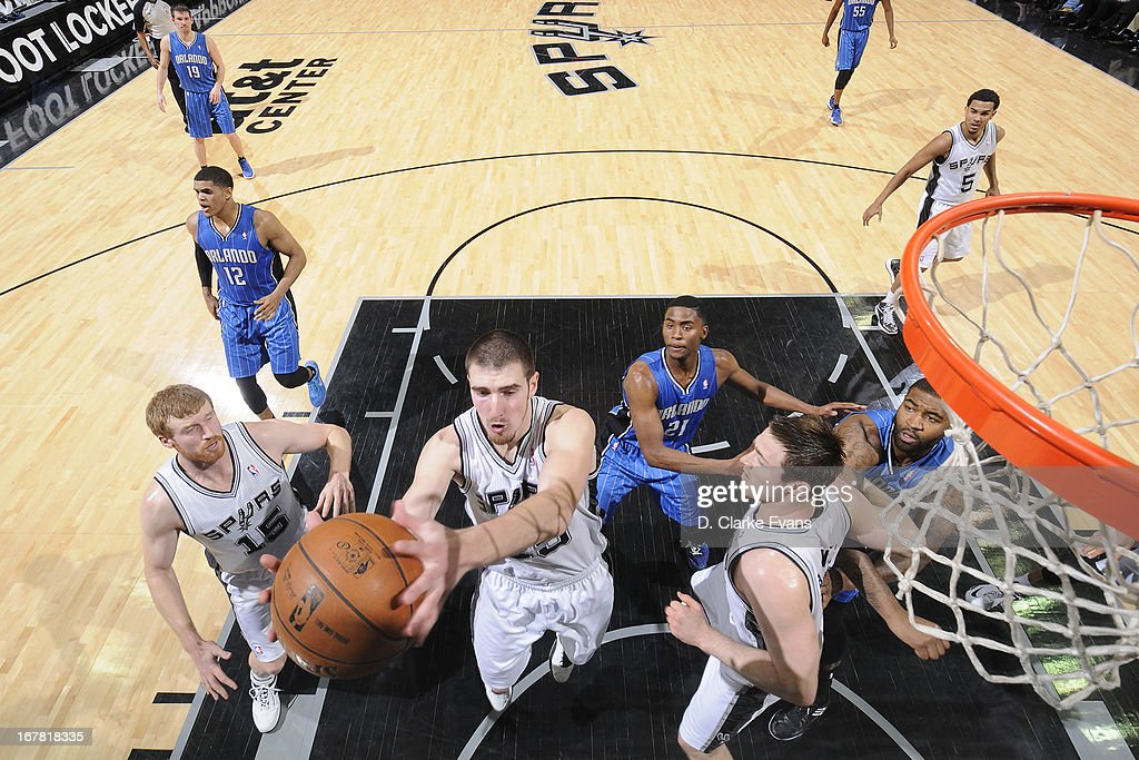 Nando de Colo #25 of the San Antonio Spurs grabs a rebound against the Orlando Magic on April 3, 2013 at the AT&T Center in San Antonio, Texas.