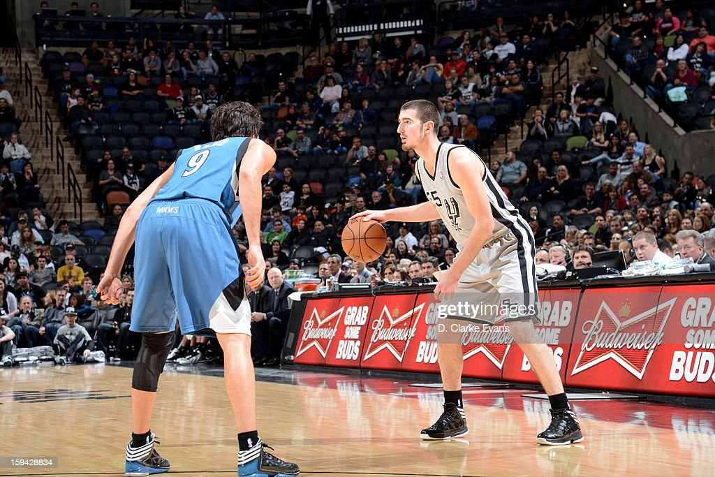 Nando de Colo #25 of the San Antonio Spurs handles the ball against Ricky Rubio #9 of the Minnesota Timberwolves on January 13, 2013 at the AT&T Center in San Antonio, Texas.