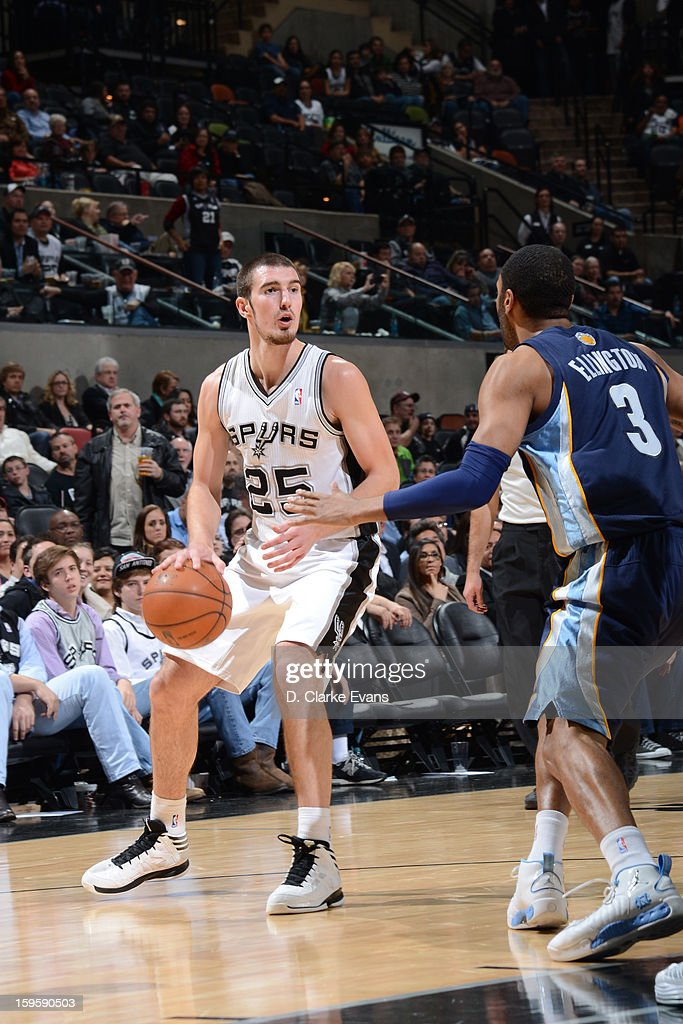 Nando de Colo #25 of the San Antonio Spurs handles the ball against Wayne Ellington #3 of the Memphis Grizzlies on January 16, 2013 at the AT&T Center in San Antonio, Texas.