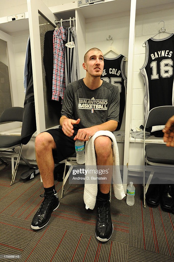 Nando de Colo of the San Antonio Spurs in the locker room before Game One of the 2013 NBA Finals against the Miami Heat on June 6 2013 at American...