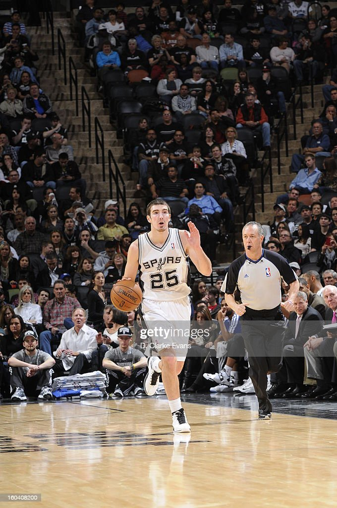 Nando de Colo #25 of the San Antonio Spurs pushes the ball up the floor against the Charlotte Bobcats on January 30, 2013 at the AT&T Center in San Antonio, Texas.