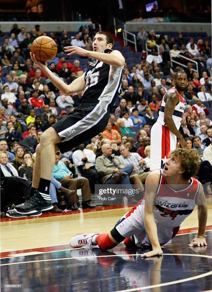 Nando de Colo #25 of the San Antonio Spurs puts up a shot in front of <a gi-track='captionPersonalityLinkClicked' href=/galleries/search?phrase=Jan+Vesely&family=editorial&specificpeople=5620499 ng-click='$event.stopPropagation()'>Jan Vesely</a> #24 of the Washington Wizards during the second half at Verizon Center on November 26, 2012 in Washington, DC.