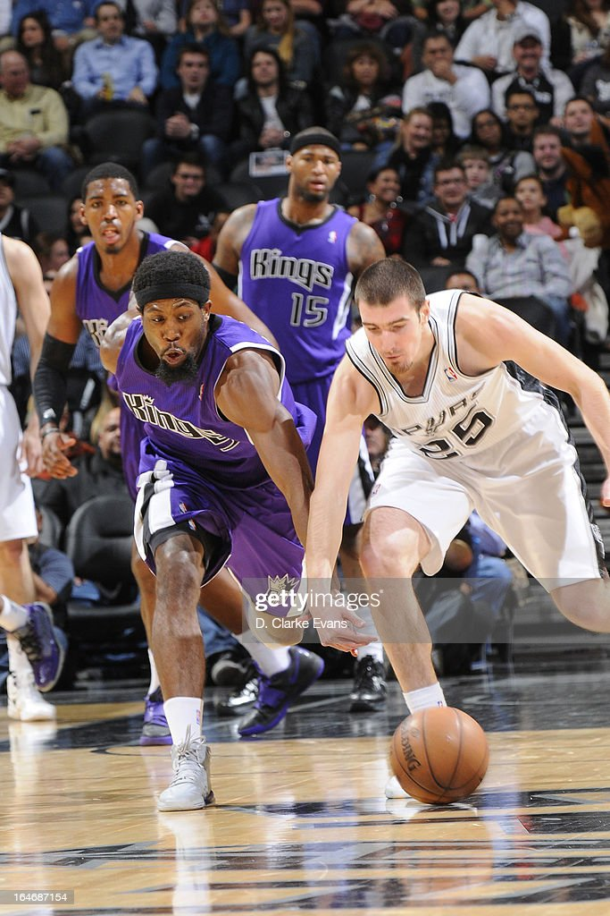 Nando de Colo #25 of the San Antonio Spurs runs for a loose ball against <a gi-track='captionPersonalityLinkClicked' href=/galleries/search?phrase=John+Salmons&family=editorial&specificpeople=202524 ng-click='$event.stopPropagation()'>John Salmons</a> #5 of the Sacramento Kings on March 1, 2013 at the AT&T Center in San Antonio, Texas.