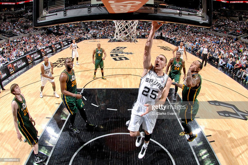 Nando de Colo #25 of the San Antonio Spurs shoots a layup against the Utah Jazz on March 22, 2013 at the AT&T Center in San Antonio, Texas.