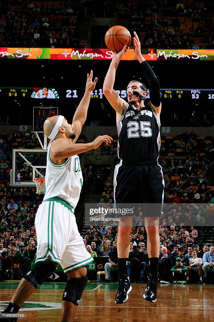 Nando De Colo of the San Antonio Spurs shoots against the Boston Celtics on February 12 2014 at the TD Garden in Boston Massachusetts NOTE TO USER...