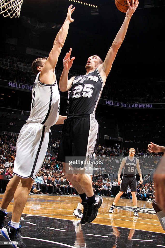 Nando de Colo #25 of the San Antonio Spurs shoots in the lane against <a gi-track='captionPersonalityLinkClicked' href=/galleries/search?phrase=Kris+Humphries&family=editorial&specificpeople=209199 ng-click='$event.stopPropagation()'>Kris Humphries</a> #43 of the Brooklyn Nets on February 10, 2013 at the Barclays Center in the Brooklyn borough of New York City.