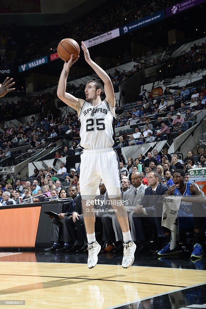 Nando de Colo of the San Antonio Spurs shoots the ball against the Orlando Magic during the first preseason game at the ATT Center on October 22 2013...