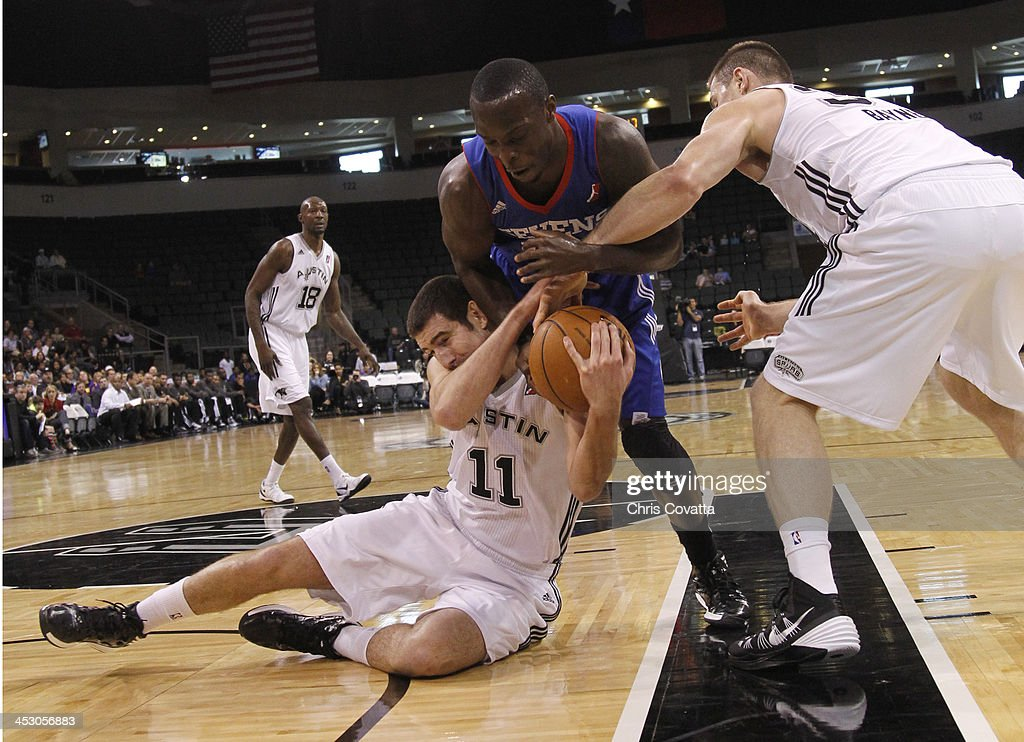 Nando Decolo and Aron Baynes of the Austin Toros battle for the ball with Mfon Udofia of the Delaware 87ers on December 1 2013 at the Cedar Park...