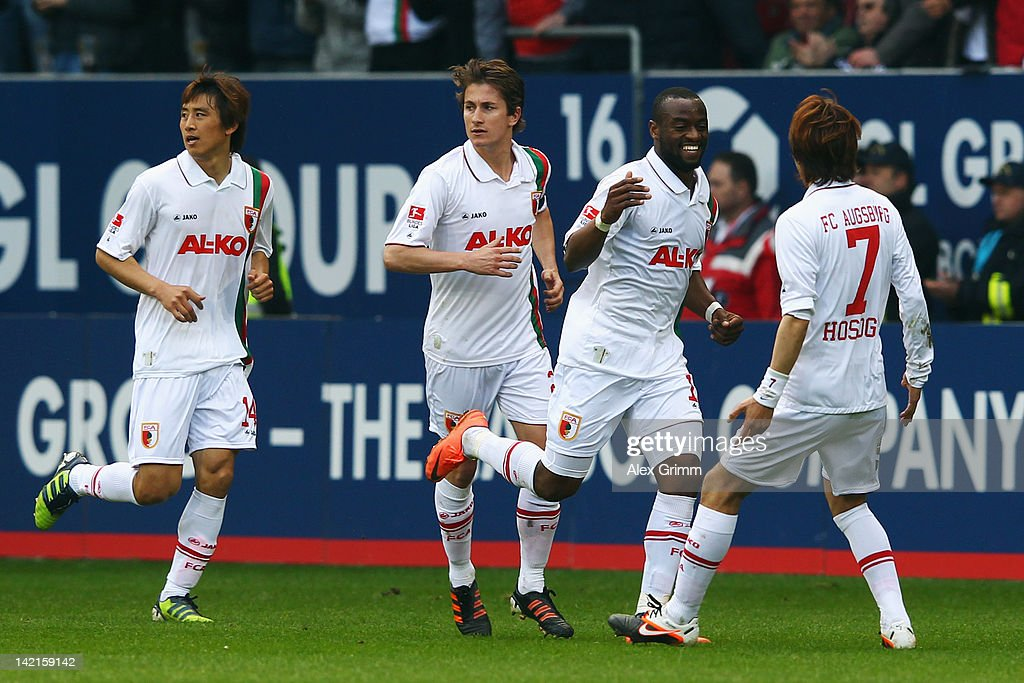 Nando Rafael of Augsburg celebrates his team's second goal with team mates JaCheol Koo Paul Verhaegh and Hajime Hosogai during the Bundesliga match...