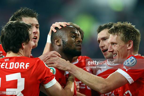 Nando Rafael of Duesseldorf celebrates the first goal with Robbie Kruse and Axel Bellinghausen of Duesseldorf during the DFB Cup second round match...