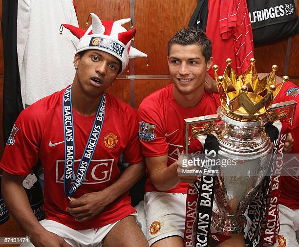 Nani and Cristiano Ronaldo of Manchester United celebrate with the Premier League Trophy in the dressing room after the Barclays Premier League match...