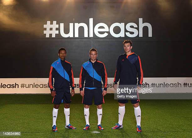 Nani and Tom Cleverley of Manchester United pose alongside Edin Dzeko of Manchester City for a portrait at the launch of the new adidas Predator...