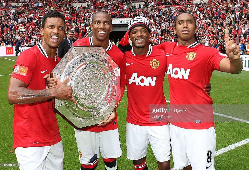 Nani, Ashley Young, Patrice Evra and Anderson of Manchester United pose with the Community Shield trophy after the FA Community Shield match between Manchester City and Manchester United at Wembley Stadium on August 7, 2011 in London, England.
