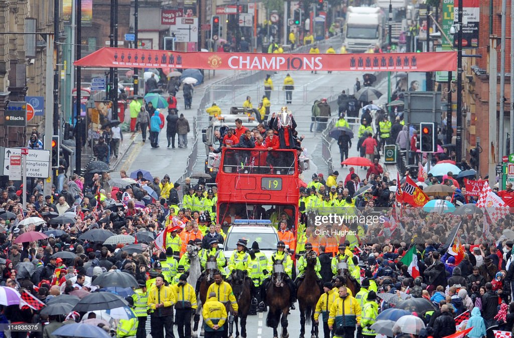 Nani (R), Dimitar Berbatov (2 R) and team mates of Manchester United during the Manchester United Premier League Winners Parade on May 30, 2011 in Manchester, England