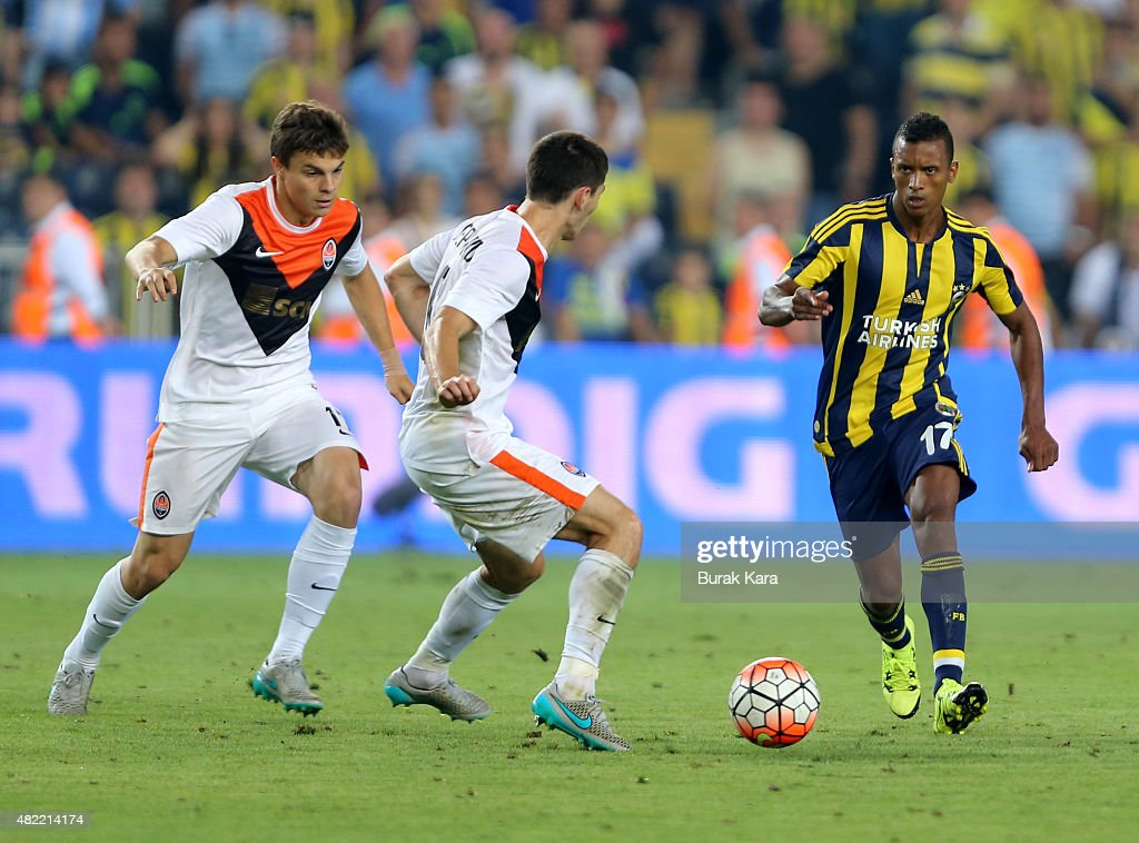 Nani of Fenerbahce rides the ball past Taras Stepanenko of Shakhtar Donetsk during UEFA Champions League Third Qualifying Round 1st Leg match betweeen Fenerbahce v Shakhtar Donetsk at Sukru Saracoglu Stadium on July 28, 2015 in Istanbul, Turkey.