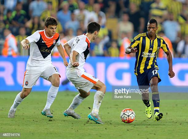 Nani of Fenerbahce rides the ball past Taras Stepanenko of Shakhtar Donetsk during UEFA Champions League Third Qualifying Round 1st Leg match...