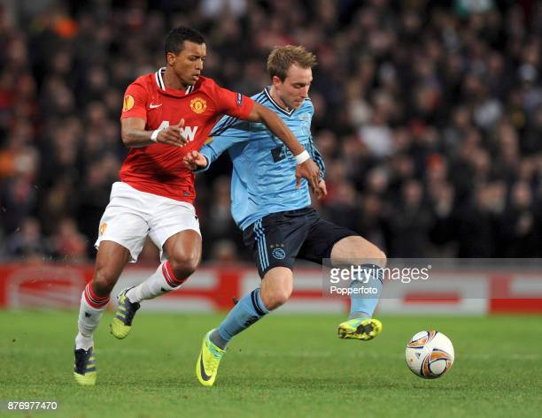 Nani of Manchester United and Christian Eriksen of Ajax in action during a Europa League match at Old Trafford on February 23 2012 in Manchester...