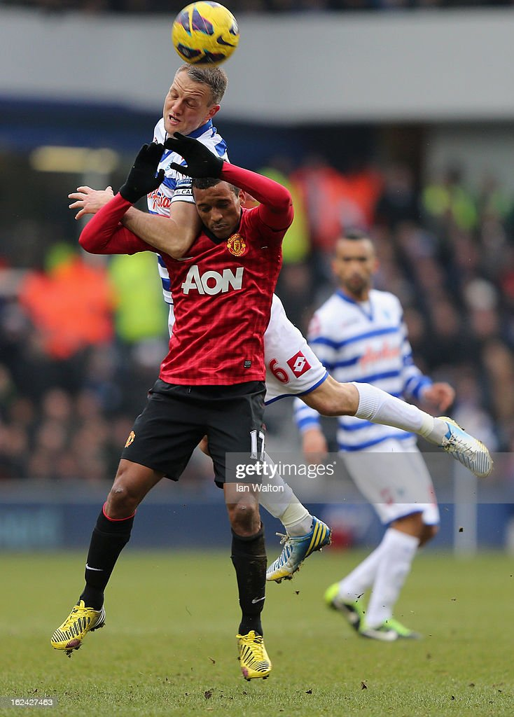 Nani of Manchester United and Clint Hill of QPR in action during the Barclays Premier League match between Queens Park Rangers and Manchester United at Loftus Road on February 23, 2013 in London, England.