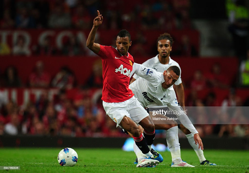 Nani of Manchester United and Jake Livermore of Tottenham Hotspur