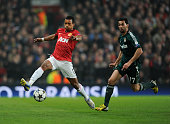 Nani of Manchester United and Álvaro Arbeloa of Real Madrid in action during the UEFA Champions League Round of 16 second leg match between...