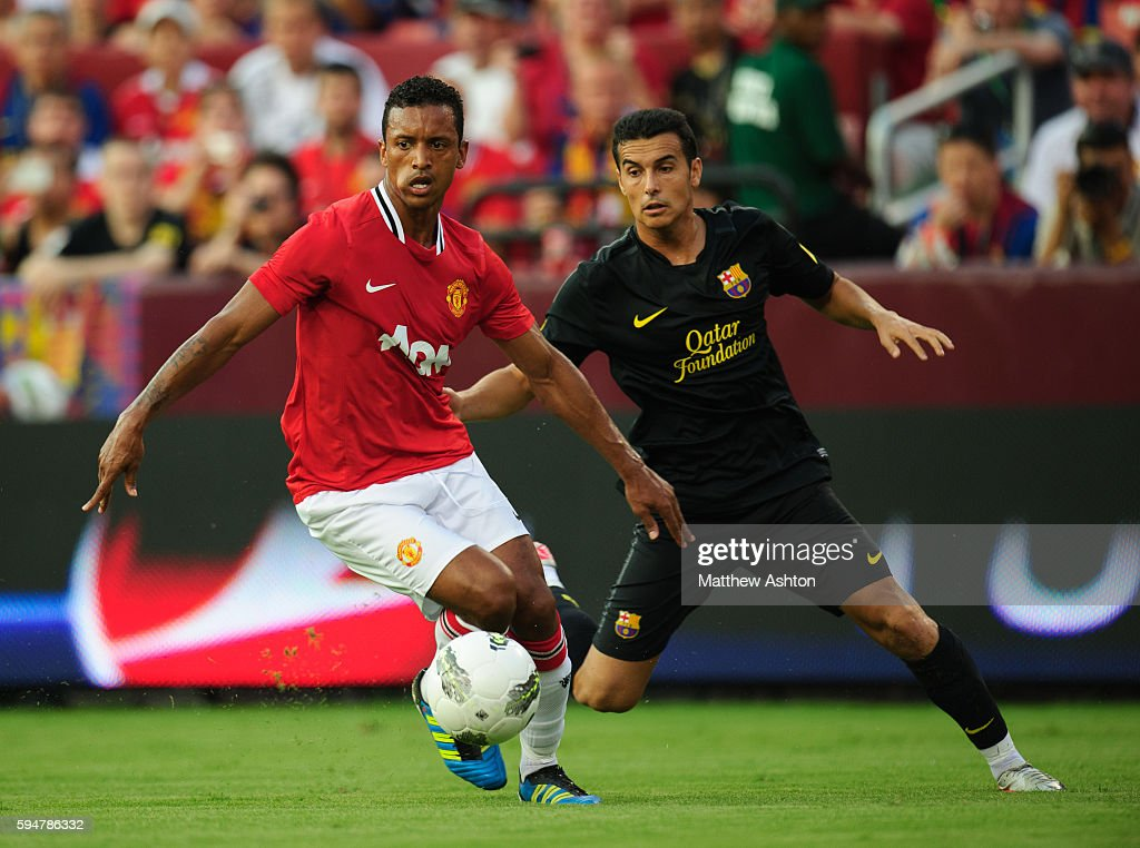 Nani of Manchester United and Pedro of FC Barcelona