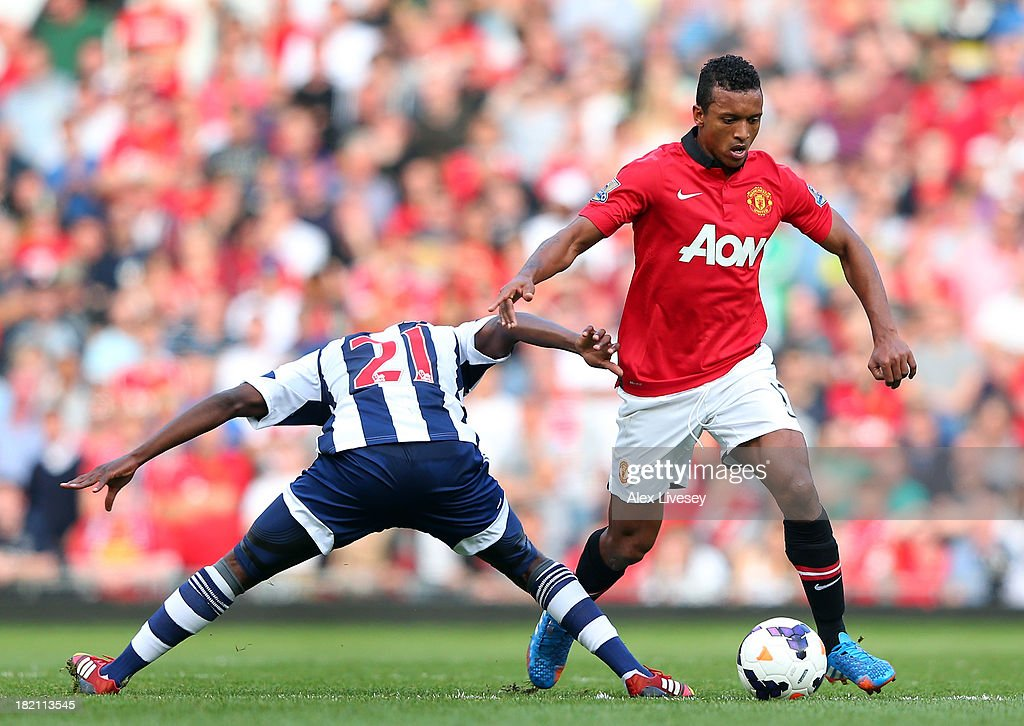 Nani of Manchester United beats Youssouf Mulumbu of West Bromwich Albion during the Barclays Premier League match between Manchester United and West Bromwich Albion at Old Trafford on September 28, 2013 in Manchester, England.