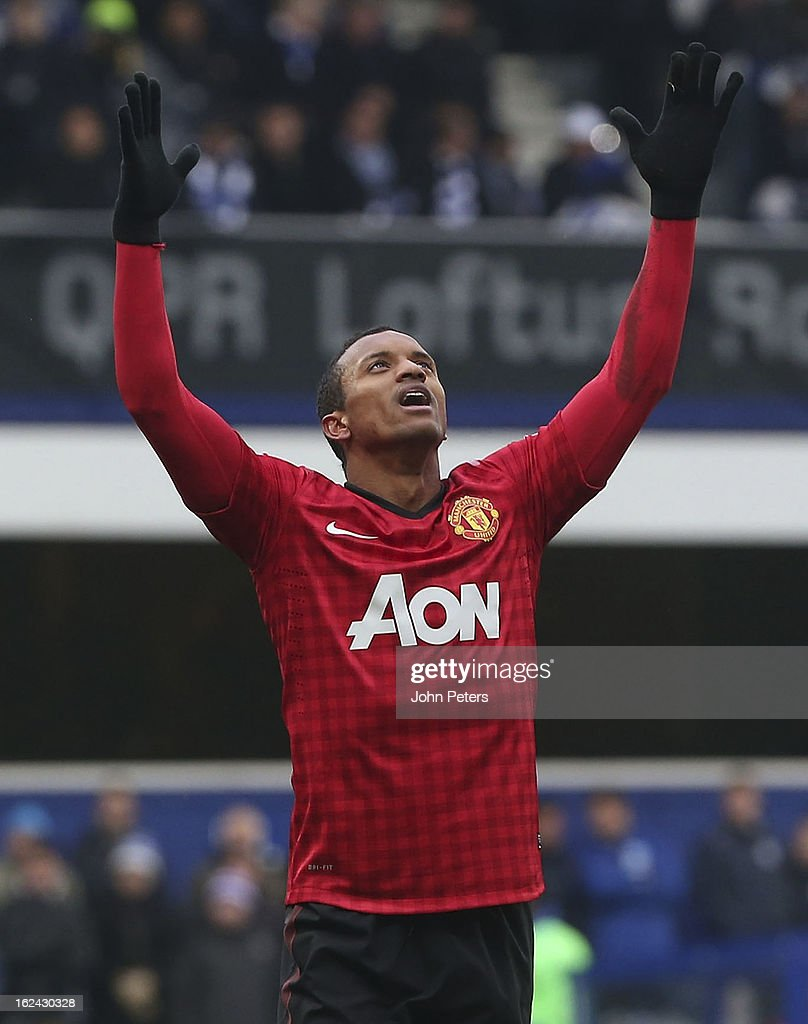Nani of Manchester United celebrates Ryan Giggs scoring their second goal during the Barclays Premier League match between Queens Park Rangers and Manchester United at Loftus Road on February 23, 2013 in London, England.