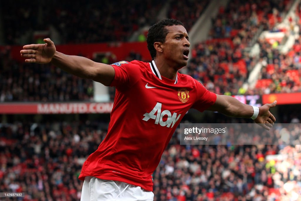 Nani of Manchester United celebrates scoring his team's fourth goal during the Barclays Premier League match between Manchester United and Aston...