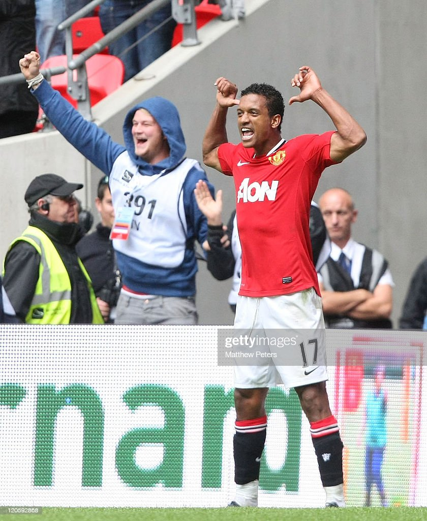 Nani of Manchester United celebrates scoring their third goal during the FA Community Shield match between Manchester City and Manchester United at Wembley Stadium on August 7, 2011 in London, England.
