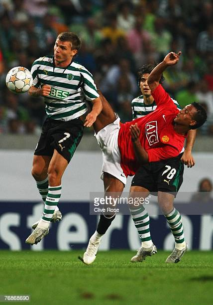 Nani of Manchester United challenges Marat Izmailov of Sporting Lisbon during the UEFA Champions League Group F match between Sporting Lisbon and...