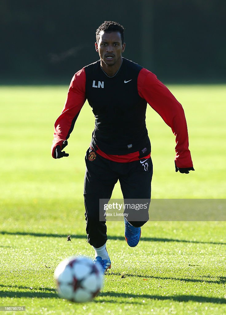 Nani of Manchester United chases the ball during a training session at Aon Training Complex on November 4, 2013 in Manchester, England.