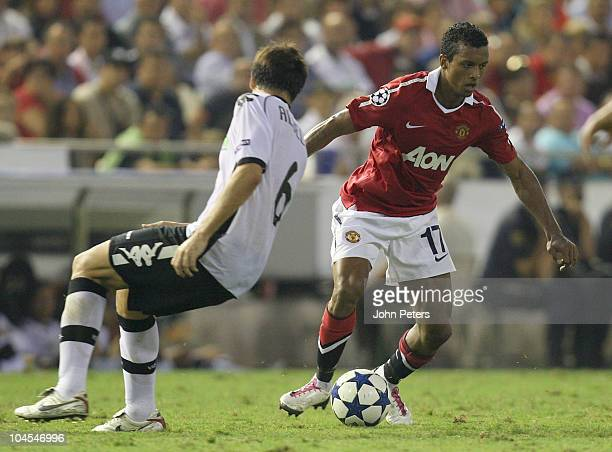 Nani of Manchester United clashes with David Albelda of Valencia during the UEFA Champions League Group C match between Valencia and Manchester...