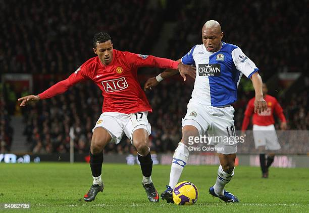 Nani of Manchester United clashes with ElHadji Diouf of Blackburn Rovers during the Barclays Premier League match between Manchester United and...